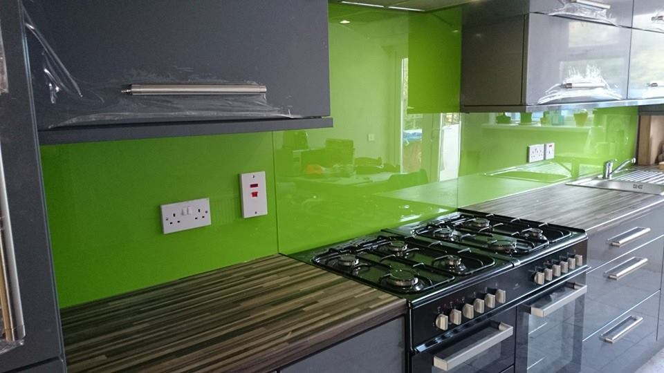 Bright green kitchen glass splashbacks